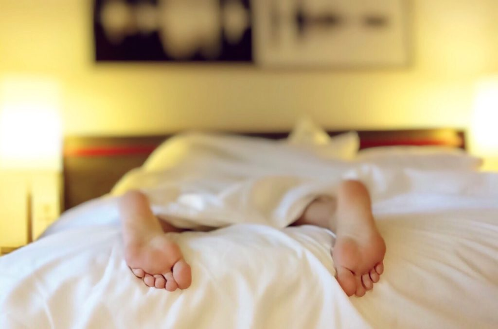 sleeping in a hotel bed