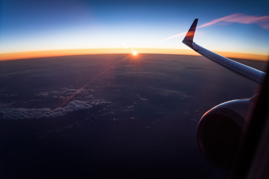 plane window, sunrise